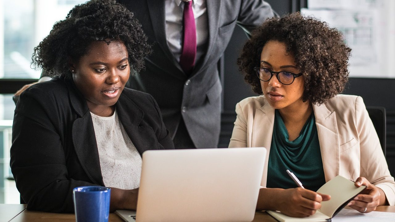 Picture of two business women working together